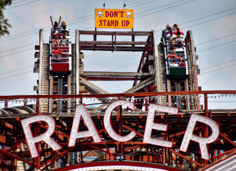 This image shows the Racer roller coaster, a dueling wooden coaster. This ride is extremely popular for its uniqueness and classic ride experience.